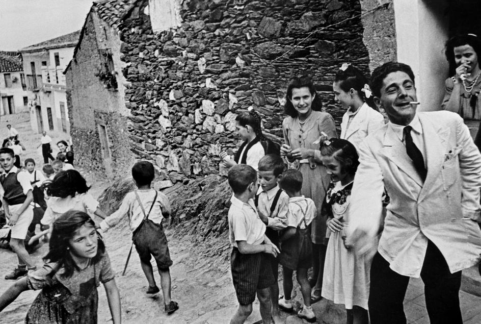 """Eugene Smith © magnum 1951 SPAIN. Village of Deleitosa in Western Spain. 1951. - SPAIN. Extremadura. Province of Caceres. Deleitosa. 1951. People waiting to go to church to attend First Communion ceremonies. From """"Spanish Village"""" photo-essay. - W-Eugene--Smith SPAIN. Extremadura. Province of Caceres. Deleitosa. 1951. People waiting to go to church to attend First Communion ceremonies. From """"Spanish Village"""" photo-essay"""