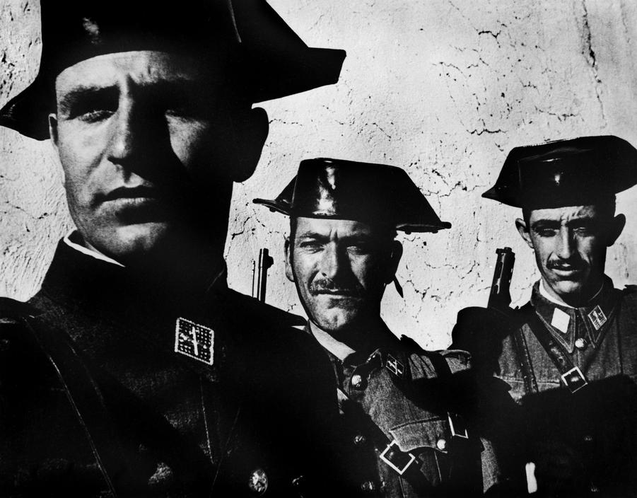"Eugene Smith © Magnum 1951 SPAIN. Village of Deleitosa in Western Spain. 1951. - SPAIN. Extremadura. Province of Caceres. Deleitosa. 1951. Members of the Guardia Civil, the rural police force in charge of patrolling the countryside. From ""Spanish Village"" photo-essay. - W-Eugene--Smith SPAIN. Extremadura. Province of Caceres. Deleitosa. 1951. Members of the Guardia Civil, the rural police force in charge of patrolling the countryside. From ""S"